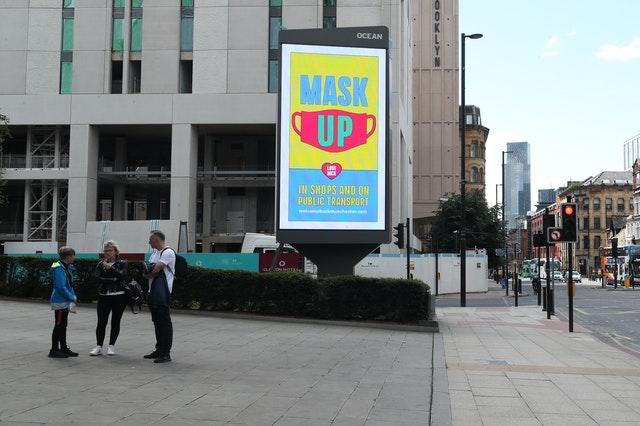 Advertising in Manchester promoting the wearing of masks (Peter Byrne/PA)