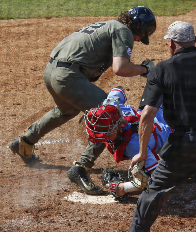 Vanderbilt's Julian Infante (22) is called safe at home as Mississippi catcher Cooper Johnson (13) tires to tag him during the fifth inning of the Southeastern Conference tournament NCAA college baseball championship game, Sunday, May 26, 2019, in Hoover, Ala. (AP Photo/Butch Dill)