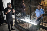 """This image released by Sony Pictures shows director Andy Serkis, left, and Woody Harrelson, right, on the set of """"Venom: Let There Be Carnage."""" (Jay Maidment/Sony Pictures Entertainment via AP)"""