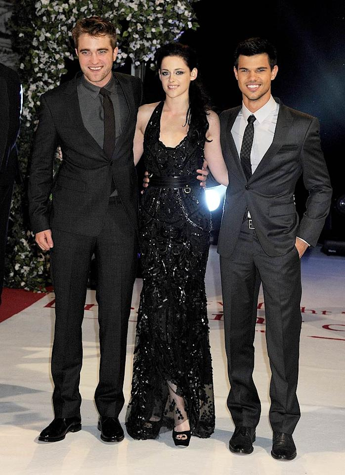 "It's been a big ""Breaking Dawn"" week. After attending the fan frenzy that was the Los Angeles premiere of ""The Twilight Saga: Breaking Dawn: Part 1"" on Monday, stars Robert Pattinson, Kirsten Stewart, and Taylor Lautner jetted across the pond to do it all again in London. (11/16/2011)"