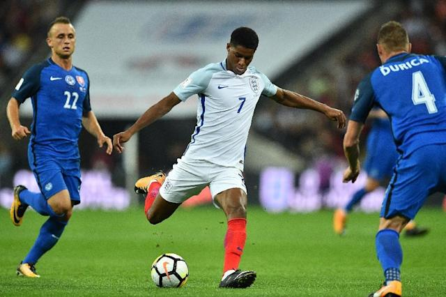 England's striker Marcus Rashford shoots to score England's second goal during the World Cup 2018 qualification football match against Slovakia September 4, 2017 (AFP Photo/Glyn KIRK )