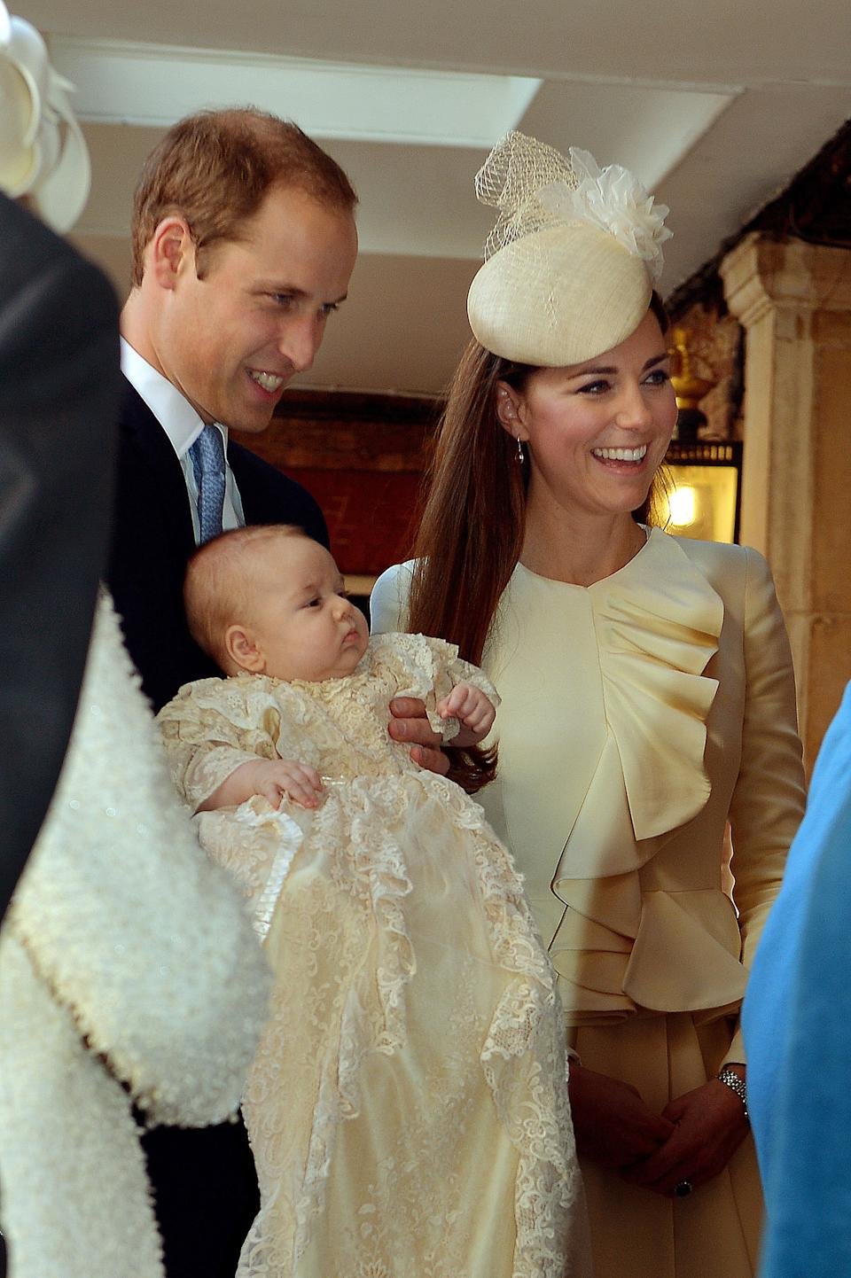 The Duke and Duchess of Cambridge with their son Prince George arrive at Chapel Royal in St James's Palace, ahead of the christening of the three month-old Prince George of Cambridge by the Archbishop of Canterbury in central London.