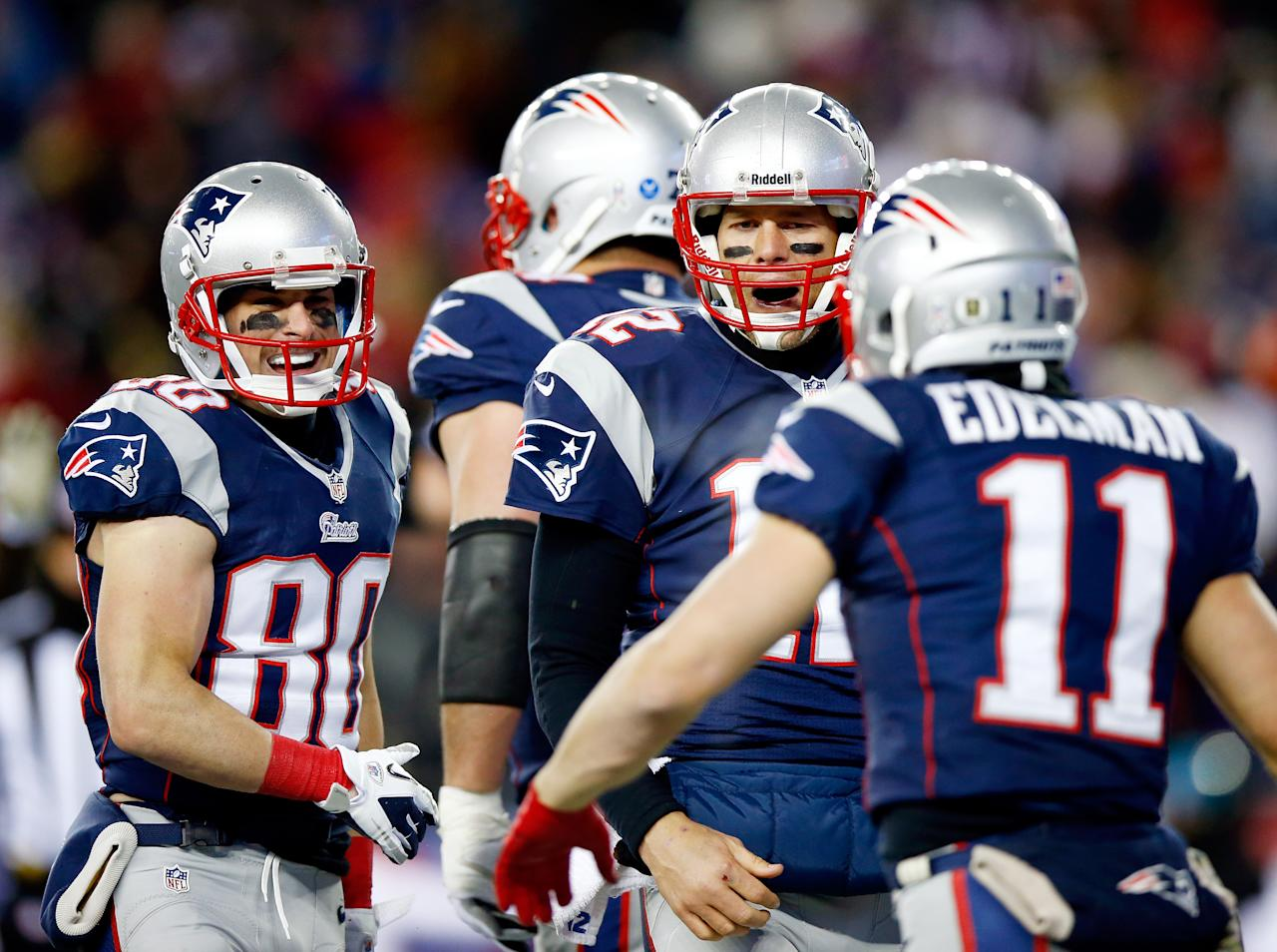 FOXBORO, MA - NOVEMBER 24: Quarterback Tom Brady #12 of the New England Patriots celebrates with wide receiver Julian Edelman #11 against the Denver Broncos during a game at Gillette Stadium on November 24, 2013 in Foxboro, Massachusetts.  (Photo by Jared Wickerham/Getty Images)
