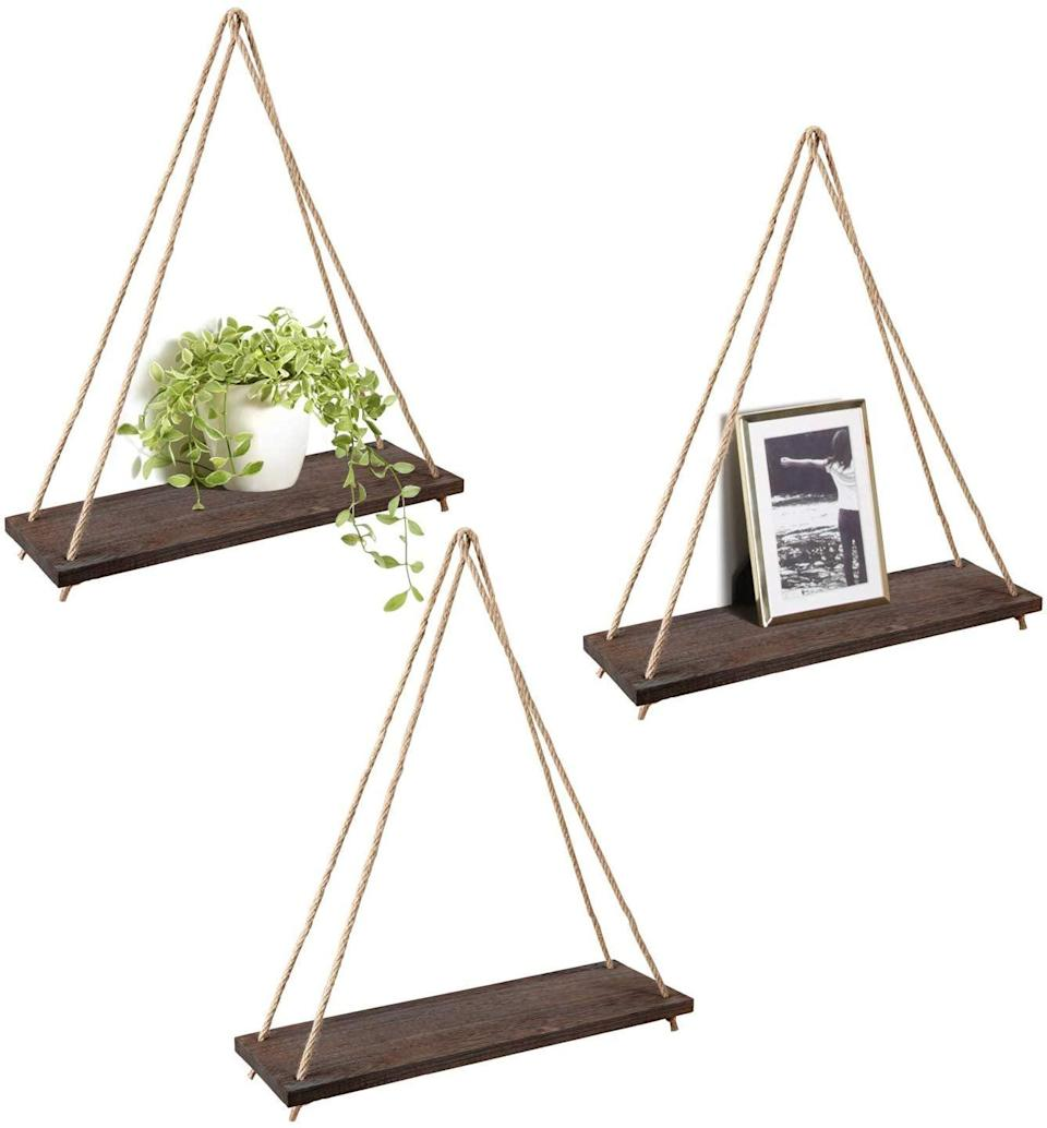 <p>These <span>Mkono Wood Wall Floating Hanging Swing Rope Shelves</span> ($23) will blend well with your nature-themed decor.</p>