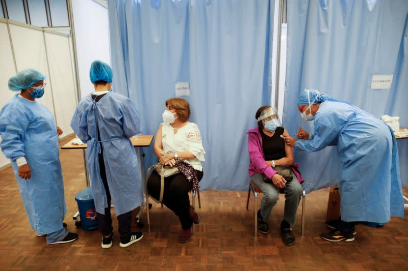 A woman receives her first dose of Russia's Sputnik V vaccine against the coronavirus disease (COVID-19), in Caracas