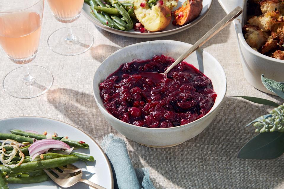 """Dark sweet cherries and apple cider lend sweetness and depth to this bourbon-and-black-pepper-spiked cranberry sauce. <a href=""""https://www.epicurious.com/recipes/food/views/cranberry-cherry-compote?mbid=synd_yahoo_rss"""" rel=""""nofollow noopener"""" target=""""_blank"""" data-ylk=""""slk:See recipe."""" class=""""link rapid-noclick-resp"""">See recipe.</a>"""
