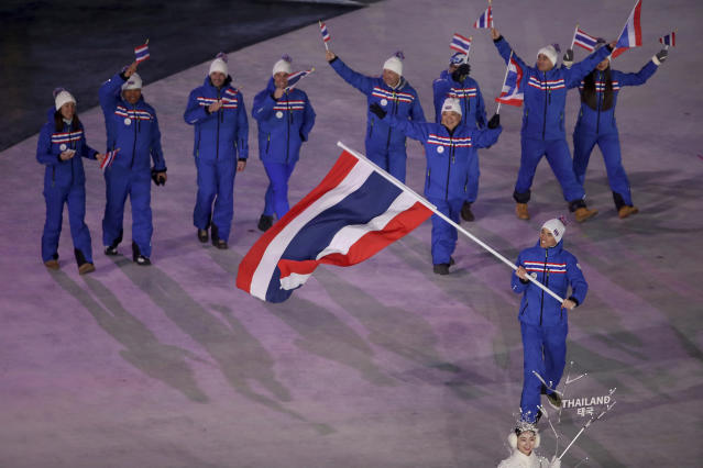 <p>Mark Chanloung carries the flag of Thailand during the opening ceremony of the 2018 Winter Olympics in Pyeongchang, South Korea, Friday, Feb. 9, 2018. (Sean Haffey/Pool Photo via AP) </p>