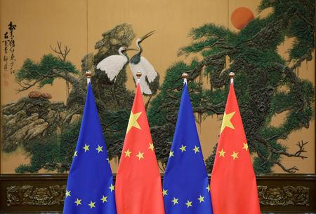 FILE PHOTO: Flags of European Union and China are pictured during the China-EU summit at the Great Hall of the People in Beijing, China, July 12, 2016. REUTERS/Jason Lee/File Photo