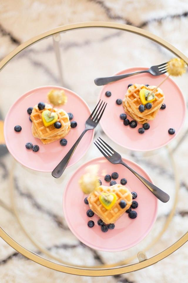 "<p>Serve up a delicious brunch and squeeze in as many heart-themed items as possible. These heart-shaped waffles with fruit cut-out will look beautiful alongside some berry-flavored Bellinis.</p><p><strong>Get the recipe at <a href=""https://lovelyindeed.com/make-heart-waffles-valentines-day/"" target=""_blank"">Lovely Indeed</a>.</strong></p><p><strong><a class=""body-btn-link"" href=""https://www.amazon.com/FASAKA-Valentines-Cookie-Cutters-Color/dp/B07ZNTKLMX/?tag=syn-yahoo-20&ascsubtag=%5Bartid%7C10050.g.30429863%5Bsrc%7Cyahoo-us"" target=""_blank"">SHOP HEART-SHAPED COOKIE CUTTERS</a><br></strong></p>"
