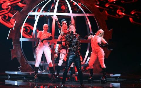Hatari of Iceland perform during the First Semi-Final  - Credit: Rex