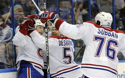 Montreal Canadiens right wing Brendan Gallagher, left, celebrates his goal with center David Desharnais (51) and defenseman P.K. Subban (76) during the third period of an NHL hockey game against the Tampa Bay Lightning, Saturday, March 9, 2013, in Tampa, Fla. (AP Photo/Brian Blanco)