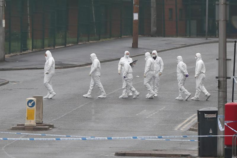 Police officers at the scene on King Street, Blackburn, following the death of a woman from a suspected gunshot wound on Sunday. PA Photo. Picture date: Monday May 18, 2020.See PA story POLICE Blackburn. Photo credit should read: Peter Byrne/PA Wire