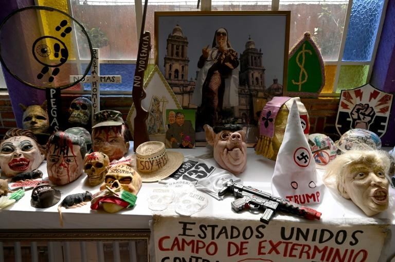 Toy guns, banners and masks of all kinds are among Klug's arsensal of protest gear, for which she has become well-known in Mexico City