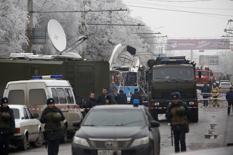 Military vehicles surround a wreckage of a trolleybus, in Volgograd, Russia, Monday, Dec. 30, 2013. A bomb blast tore through a trolleybus in the city of Volgograd on Monday morning, killing at least 10 people a day after a suicide bombing that killed at least 17 at the city's main railway station. Volgograd is about 650 kilometers (400 miles) northeast of Sochi, where the Olympics are to be held. (AP Photo/Denis Tyrin)