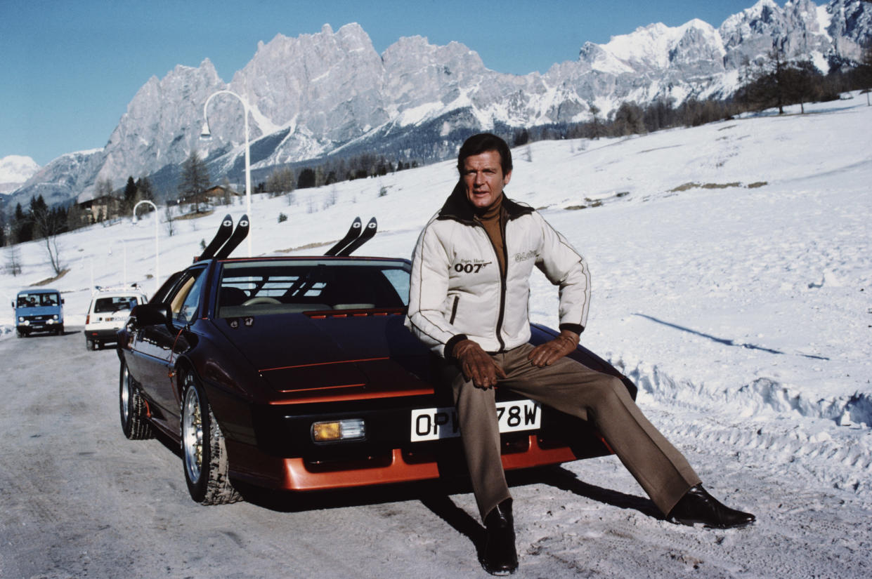 English actor Roger Moore poses as 007, with a Lotus Esprit Turbo, on the set of the James Bond film 'For Your Eyes Only', February 1981. (Photo by Keith Hamshere/Getty Images)