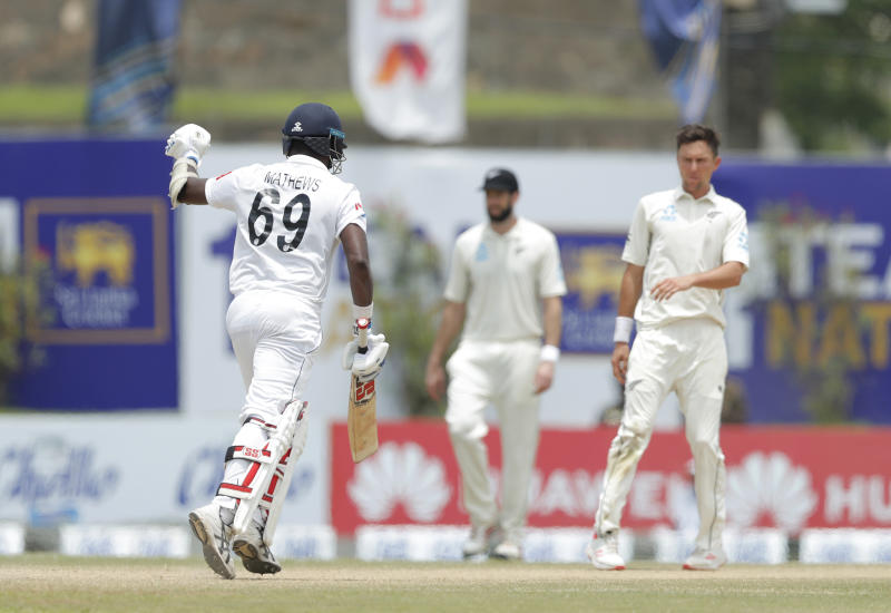 Sri Lanka's Angelo Mathews punches in the air as he completes the winning run over New Zealand in the first test cricket match in Galle, Sri Lanka, Sunday, Aug. 18, 2019. (AP Photo/Eranga Jayawardena)