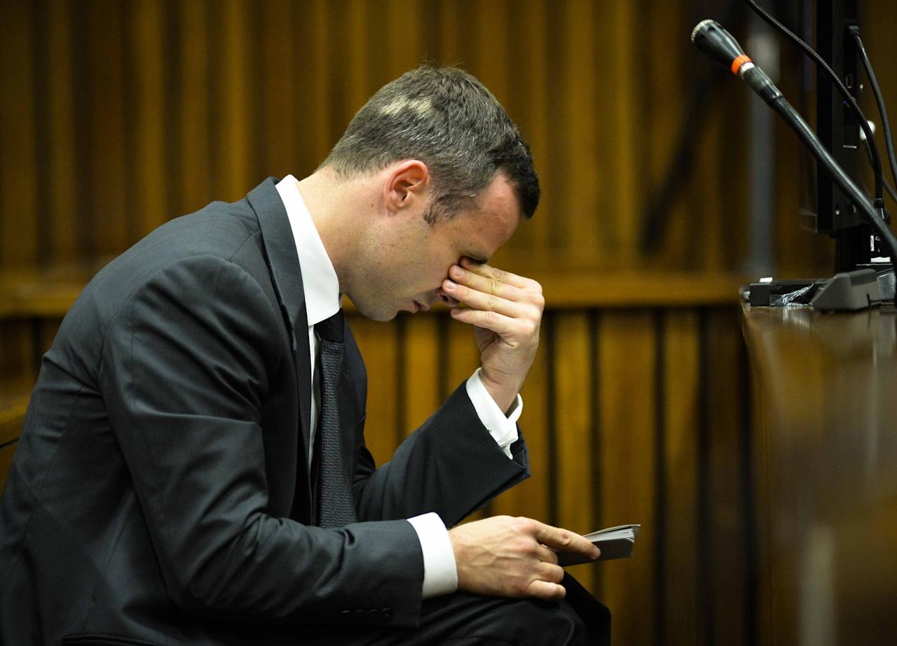 Oscar Pistorius listens to evidence in court on the fifth day of his trial at the high court in Pretoria, South Africa, Friday, March 7, 2014. Pistorius is charged with murder for the shooting death of his girlfriend, Reeva Steenkamp, on Valentines Day in 2013. (AP Photo/Theana Breugem, Pool)