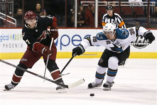 Phoenix Coyotes' Radim Vrbata (17), of the Czech Republic, gets a pass off in front of San Jose Sharks' Logan Couture (39) in the first period during an NHL hockey game, on Monday, April 15, 2013 in Glendale, Ariz. (AP Photo/Ross D. Franklin)