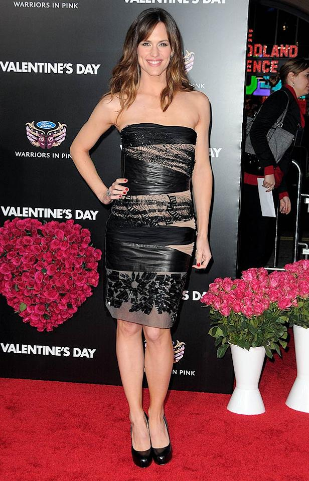 """Jennifer Garner wowed the crowd (and fashion critics alike) at the highly anticipated """"Valentine's Day"""" debut in a sexy, strapless Valentino dress, which featured nude cut-outs, leather wrapping, and a beautifully beaded hemline. Black Brian Atwood """"Maniac"""" pumps completed her luxurious look. Jordan Strauss/<a href=""""http://www.wireimage.com"""" target=""""new"""">WireImage.com</a> - February 8, 2010"""