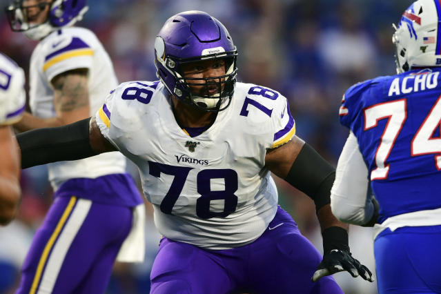 FILE - In this Aug. 29, 2019, file photo, Minnesota Vikings offensive guard Dakota Dozier (78) blocks during the first half of an NFL preseason football game against the Buffalo Bills in Orchard Park, N.Y. The Vikings have re-signing the veteran guard, who played in 16 games last season with a career-high four starts. (AP Photo/David Dermer, File)