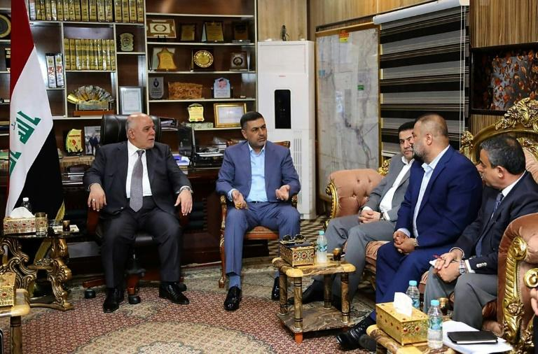 Iraqi Prime Minister Haider al-Abadi (L) meets with local officials in the southern city of Basra on September 10, 2018