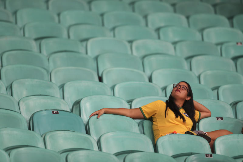 A Brazilian fan rests after a Copa America Group A soccer match against Venezuela at the Arena Fonte Nova in Salvador, Brazil, Tuesday, June 18, 2019. The match end 0-0. (AP Photo/Natacha Pisarenko)