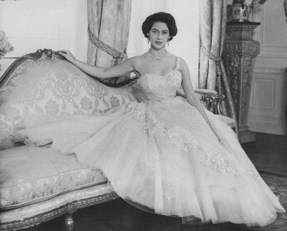 <p>Margaret posed for her 26th birthday portrait wearing a one-shouldered pink tulle gown. The dress featured elaborate flower embroidery and sequins. </p>