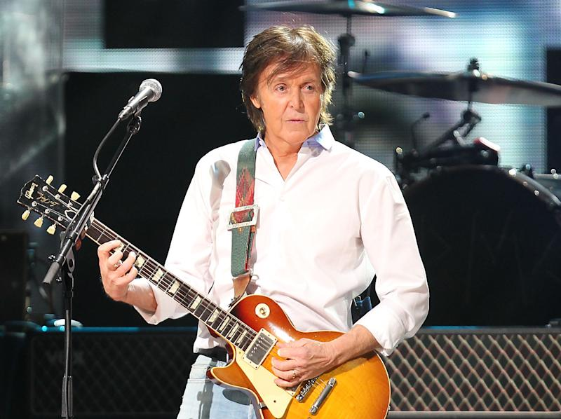 FILE - This Dec. 12, 2012 file image released by Starpix shows Paul McCartney at the 12-12-12 The Concert for Sandy Relief at Madison Square Garden in New York.  McCartney is adding his voice to Tony Bennett's campaign against gun violence. The former Beatle recorded a voice message that's part of a text-to-call operation Wednesday, April 17, 2013, for Bennett's Voices Against Violence campaign. McCartney and others are encouraging Americans to send a text, which will lead to the singer's message and connect the caller to their local senate office after proving their zip code. (AP Photo/Starpix, Dave Allocca, file)