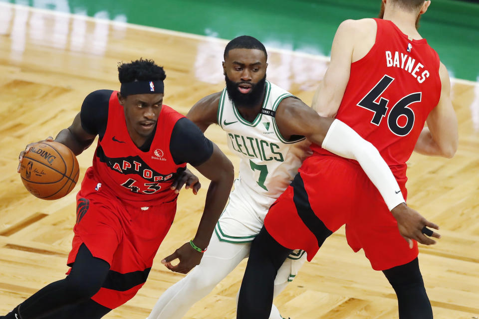 Boston Celtics' Jaylen Brown (7) defends against Toronto Raptors' Pascal Siakam (43) as Aron Baynes (46) provides a screen during the first half of an NBA basketball game, Thursday, Feb. 11, 2021, in Boston. (AP Photo/Michael Dwyer)