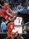 Bradley's Ja'Shon Henry, top, leaps to save a ball from going out of bounds as teammate Darrell Brown (5) and Missouri State's Keandre Cook (1) watch during the second half of an NCAA college basketball game in the quarterfinal round of the Missouri Valley Conference tournament, Friday, March 8, 2019, in St. Louis. (AP Photo/Jeff Roberson)
