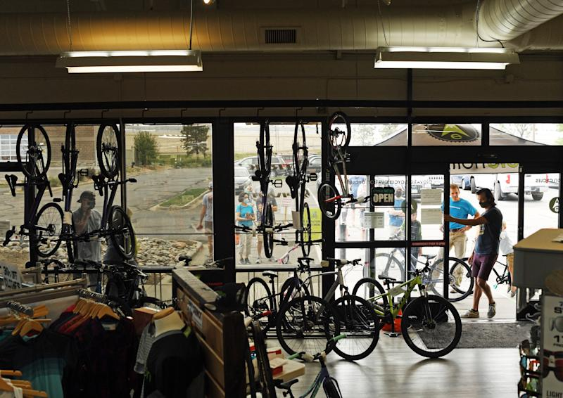 HIGHLANDS RANCH, COLORADO - MAY 31: People line up outside for their turn to get into at Elevation Cycles bike shop May 31, 2020 in Highlands Ranch, Colorado. (Photo by RJ Sangosti/MediaNews Group/The Denver Post via Getty Images)