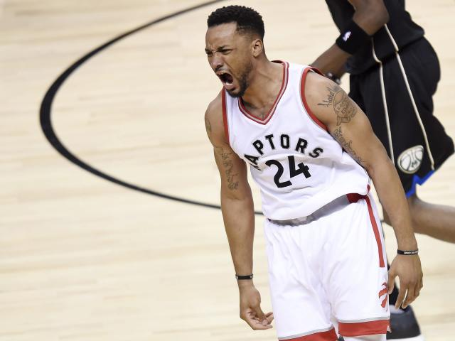 Toronto Raptors guard Norman Powell (24) reacts after dunking against the Milwaukee Bucks during the second half of game five of an NBA first-round playoff series basketball game in Toronto on Monday, April 24, 2017. (Nathan Denette/The Canadian Press via AP)