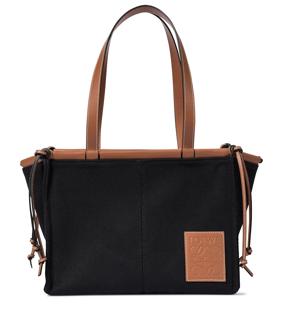 """<p><strong>Loewe</strong></p><p>mytheresa.com</p><p><strong>$1200.00</strong></p><p><a href=""""https://go.redirectingat.com?id=74968X1596630&url=https%3A%2F%2Fwww.mytheresa.com%2Fen-us%2Floewe-cushion-small-canvas-tote-1680633.html&sref=https%3A%2F%2Fwww.harpersbazaar.com%2Ffashion%2Ftrends%2Fg22591832%2Fbest-laptop-bags-for-women%2F"""" rel=""""nofollow noopener"""" target=""""_blank"""" data-ylk=""""slk:Shop Now"""" class=""""link rapid-noclick-resp"""">Shop Now</a></p><p>A little casual, a lot chic.</p>"""