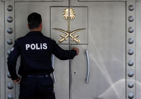 A Turkish police officer who stands guard at the Saudi Arabia's consulate is seen at the entrance, in Istanbul, Turkey October 10, 2018. REUTERS/Murad Sezer