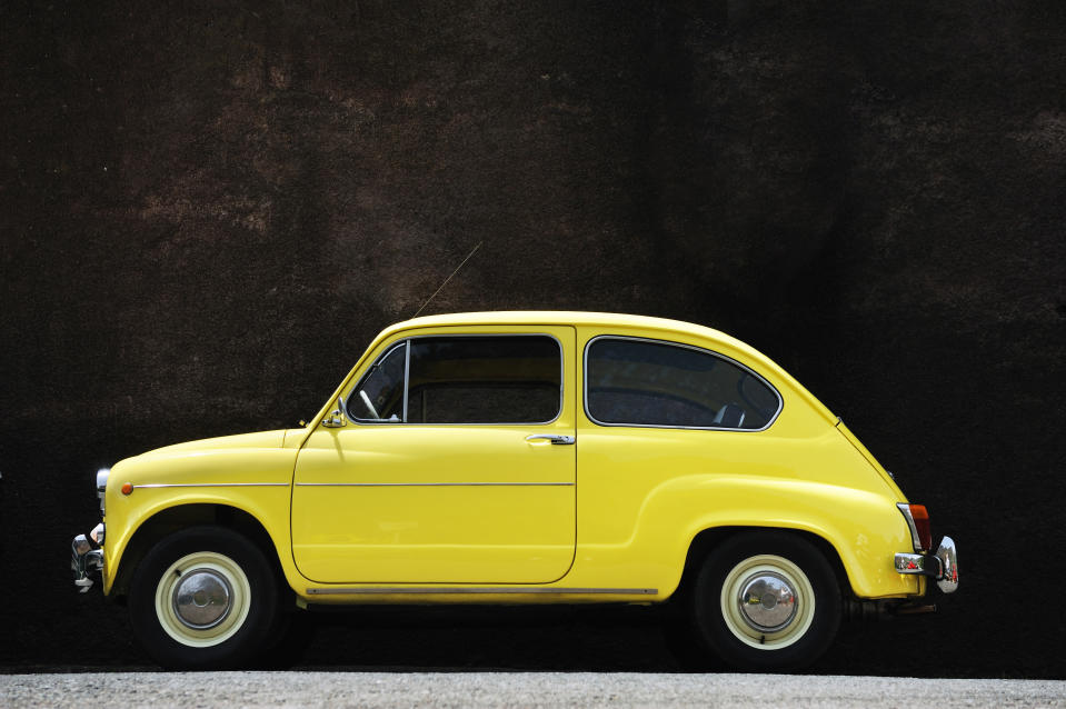 Yellow vintage car. Retro car in the mountains of Madeira.
