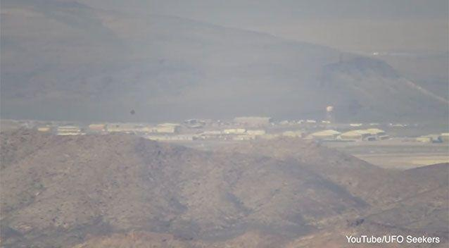 Tikaboo Peak provides one of the only vantage points over the base, which cannot be approached without risking running into heavily armed guards. Photo: YouTube/ UFO Seekers