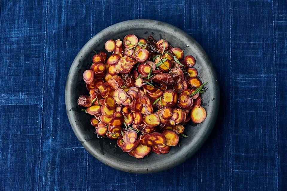 """Crunchy tender carrots tossed in a tangy-sweet dressing meet soft and blackened dates for literally everything you want in one bite. <a href=""""https://www.bonappetit.com/recipe/shaved-carrots-with-charred-dates?mbid=synd_yahoo_rss"""" rel=""""nofollow noopener"""" target=""""_blank"""" data-ylk=""""slk:See recipe."""" class=""""link rapid-noclick-resp"""">See recipe.</a>"""
