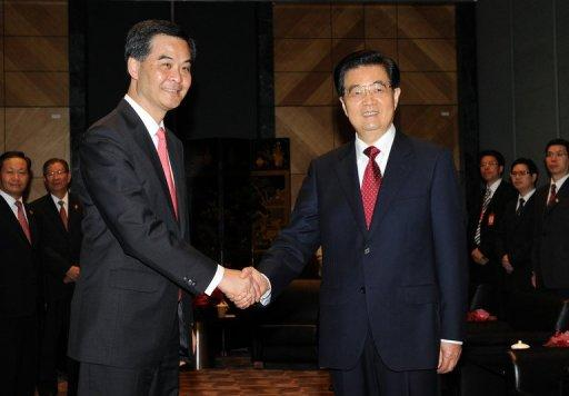 "Chinese President Hu Jintao (R) shakes hands with new Hong Kong Chief Executive Leung Chun-ying (L) after the inauguration ceremony at the Hong Kong Convention and Exhibition Centre. Chinese web users accused Jintao of ""hiding"" from protesters in Hong Kong Sunday even as state media covered the anniversary of the city's return to rule by Beijing in glowing terms"