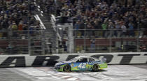 Kyle Larson crosses the finish line to win the NASCAR All-Star Race at Charlotte Motor Speedway in Concord, N.C., Saturday, May 18, 2019. (AP Photo/Chuck Burton)