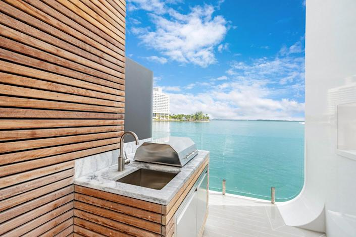 A cool coastal outdoor grill rests on the Arkup's outer edge.