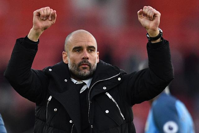Manchester City's Pep Guardiola celebrates their victory on the pitch after their match against Southampton on April 15, 2017 (AFP Photo/Glyn KIRK)