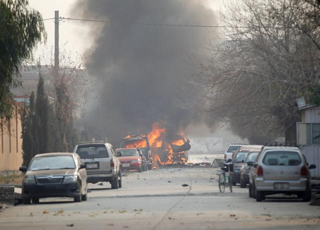 <p>Vehicles are seen on fire after a blast in Jalalabad, Afghanistan, Jan. 24, 2018. (Photo: Parwiz/Reuters) </p>