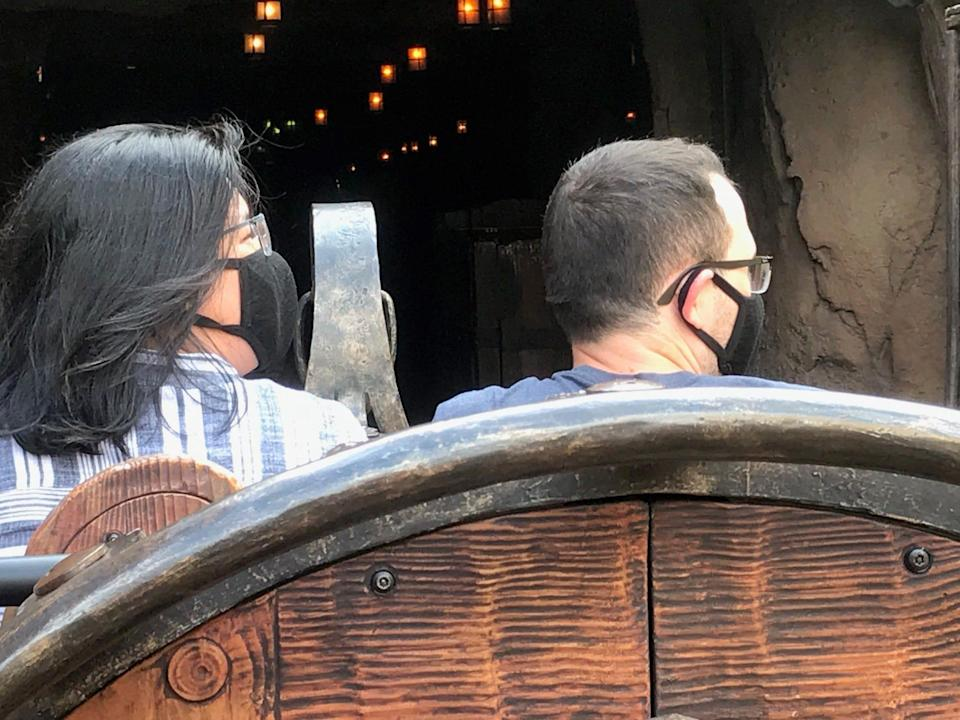 Masks are mandatory now at Walt Disney World, where a couple wearing face coverings is pictured Thursday during the first day of a passholder preview before the park officially reopens Saturday.