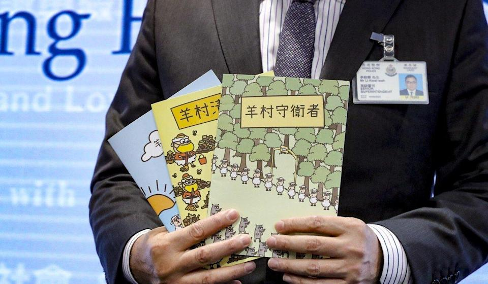 Police display the contentious children's books over which five people were arrested. Photo: Edmond So