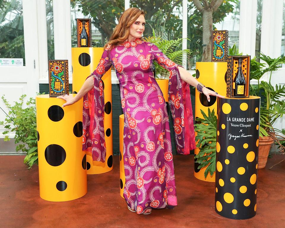 <p>Brooke Shields shows off the unique sleeves on her vibrant dress at the Veuve Clicquot Cocktail Hour at the New York Botanical Garden on June 3 in N.Y.C. </p>
