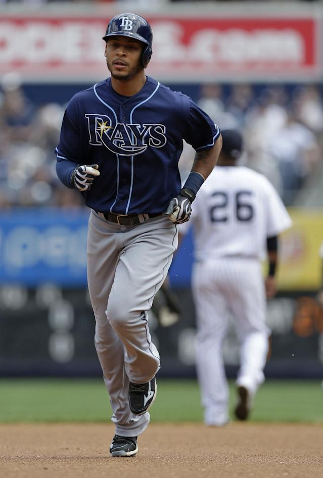 Tampa Bay Rays' Desmond Jennings runs the bases after hitting a home run during the first inning of a baseball game against the New York Yankees Saturday, May 3, 2014, in New York. (AP Photo/Frank Franklin II)