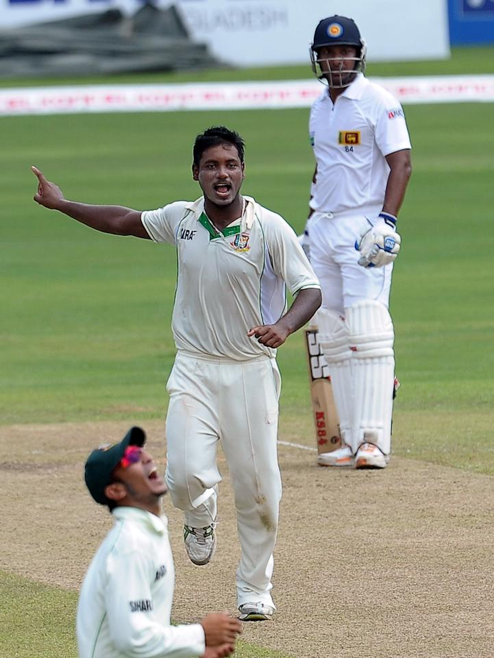 Bangladeshi cricketer Abul Hasan (C) celebrates after he dismissed Sri Lankan cricketer Dimuth Karunaratne during the second day of their second Test match between Sri Lanka and Bangladesh at the R. Premadasa Cricket Stadium in Colombo on March 17, 2013. AFP PHOTO/ LAKRUWAN WANNIARACHCHI