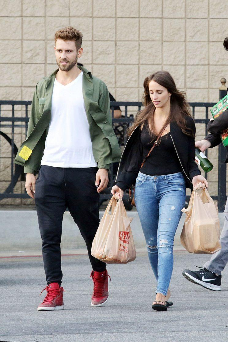 Nick Viall with Vanessa Grimaldi carrying grocery bags