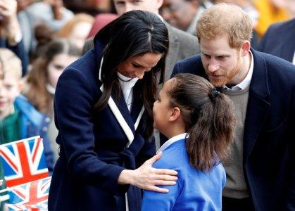 Britain's Prince Harry and his fiancee Meghan Markle meet local school children during a wakabout on a visit to Birmingham, Britain, March 8, 2018. REUTERS/Phil Noble