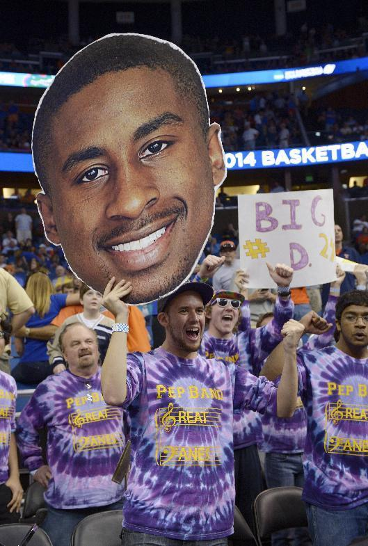 Albany fans cheer at the start of the second-round game in the NCAA college basketball tournament against Florida, Thursday, March 20, 2014, in Orlando, Fla. (AP Photo/Phelan M. Ebenhack)